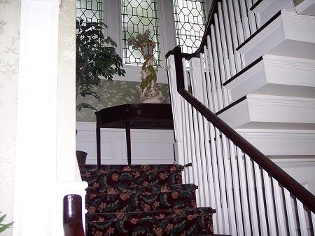 Elegant Stairway with Leaded Glass Window
