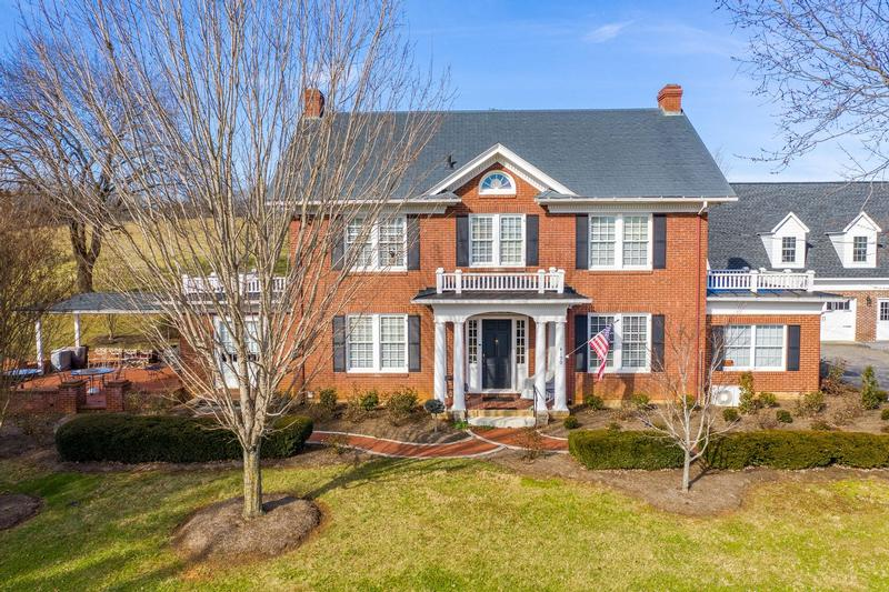 Colonial Revival with brick exterior and magnificent trim.